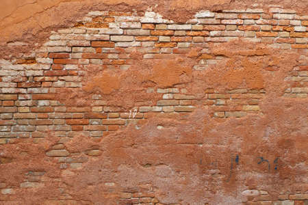 view of wall of red brick, aged