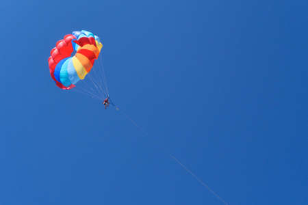 one skydiver on blue sky - extreme sport