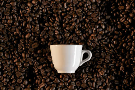 white cup and brown coffe beans - caffe espresso