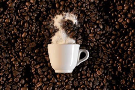 a cup of white sugar in a coffee background