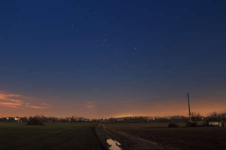 orion: A country pathway under Orion constellation Stock Photo