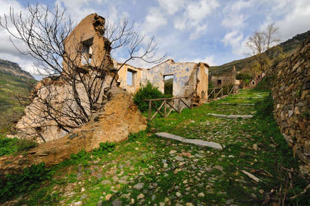 completely: Old Gairo was partially destroyed by a flood in 1951, and in 1963 it was completely abandoned, the new houses were rebuilt a little higher than the half-destroyed village   Stock Photo