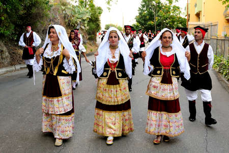 Parade of traditional costumes and masks of Sardinia Jerzu at the Wine Festival in 2014.