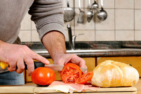 Realization sandwich stuffed with speck ham, cheese and tomato. Stock Photo