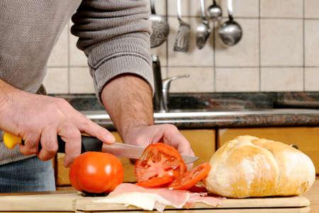 realization: Realization sandwich stuffed with speck ham, cheese and tomato. Stock Photo
