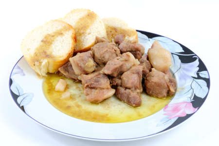 bay leaf: Pork cooked stewed with: onions, garlic, olive oil, bay leaf, salt and wine