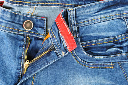 Zipper detail and the front pocket of pants in jeans for men light blue color Stock Photo
