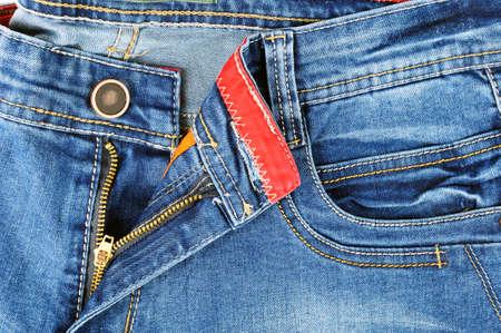 Zipper detail and the front pocket of pants in jeans for men light blue color Standard-Bild