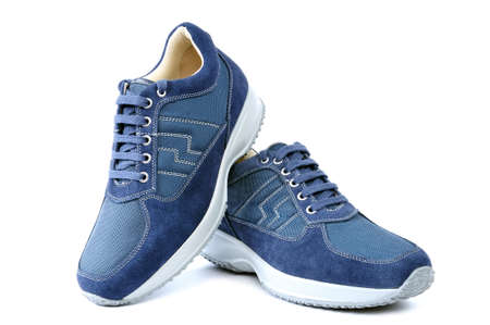 Sports shoes for adult man photographed on white background.