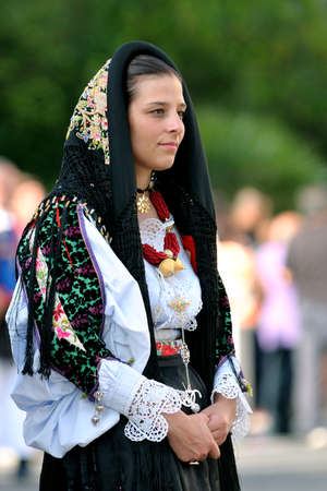 feast: Nuoro, Sardinia, Italy - August 23, 2015: Parade of traditional costumes of Sardinia on the occasion of the Feast of the Redeemer of the Aug. 23, 2015 in Nuoro, Sardinia. Editorial