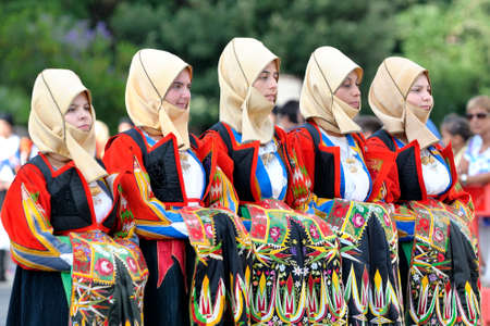 Nuoro, Sardinia, Italy - August 23, 2015: Parade of traditional costumes of Sardinia on the occasion of the Feast of the Redeemer of the Aug. 23, 2015 in Nuoro, Sardinia. Editorial