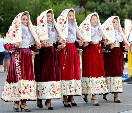 historical events: Nuoro, Sardinia, Italy - August 23, 2015: Parade of traditional costumes of Sardinia on the occasion of the Feast of the Redeemer of the Aug. 23, 2015 in Nuoro, Sardinia. Editorial