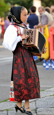 historical clothing: Nuoro, Sardinia, Italy - August 23, 2015: Musicians in the parade of traditional costumes of Sardinia on the occasion of the Feast of the Redeemer of August 23, 2015 in Nuoro, Sardinia. Editorial