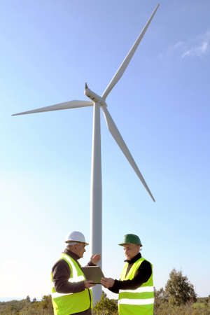 detecting: Technicians engaged in the detecting of a wind turbine installation for the production of energy Stock Photo