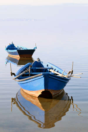 moored: Fishing boats moored in the calm sea of the gulf