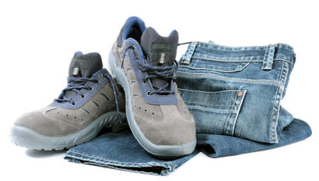 work shoes: protective work shoes for heavy work in the yard and jeans trousers