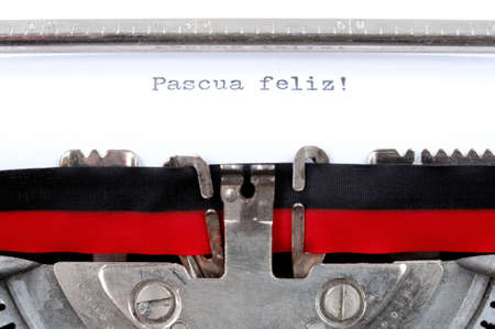 old typewriter: Text Happy Easter in Spanish language written with an old typewriter, horizontal photo