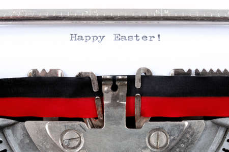 old typewriter: Happy Easter text in English written with an old typewriter, horizontal photo Stock Photo