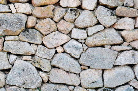 disposed: Detail picture of a stone wall irregularly disposed.