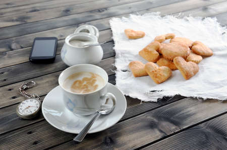 biscuits: Foods of the Italian breakfast with coffee milk and biscuits on an old wooden table