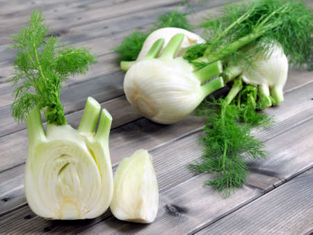 Fresh fennel cut just harvested, photographed on wooden table