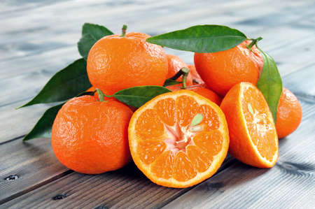 clementines: Clementines fresh products in organic farming, photographed on antique wooden table Stock Photo