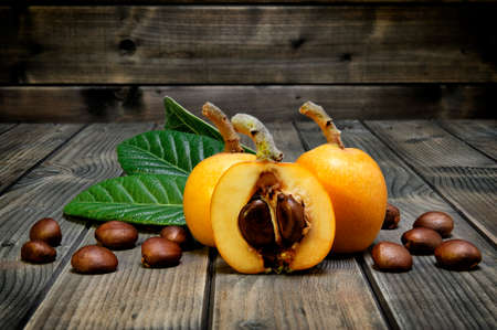 Medlars produced with organic cultivation photographed on antique wood background Standard-Bild