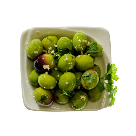 containing: Bowl containing olives seasoned with oil, salt, parsley and garlic