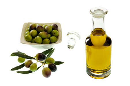 Bowl of olives and extra virgin olive oil in a glass cruet isolated on white background Stock Photo