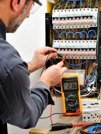 Electrician Technician At Work On A Residential Electrical Panel ...