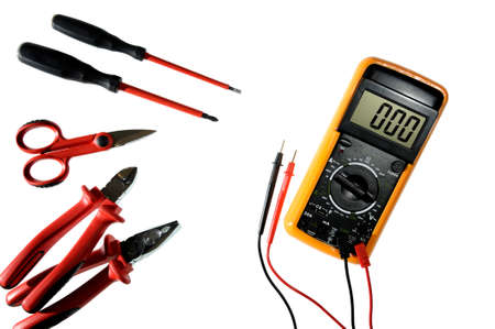 Multimeter, clamp, cable cutter, scissors and screwdriver for working on a residential electrical installation photographed on a white background Stock Photo