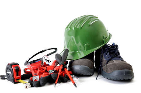 Safety equipment and tools for working on a residential electrical installation, photographed on a white background. Stock Photo