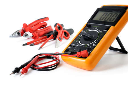 Multimeter and work tools for residential electrical installations, isolated on white background
