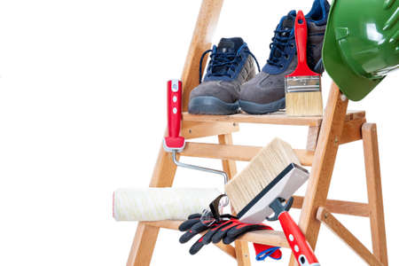 Work tools and safety equipment for professional house painter on a wooden ladder, isolated on white background