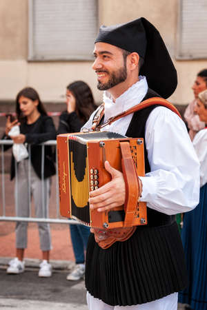 Nuoro, Sardinia, Italy - August 26 2018: Musicians with the accordion in the parade of traditional costumes of Sardinia on the occasion of the Feast of the Redeemer of the August 26, 2018 in Nuoro, Sardinia.