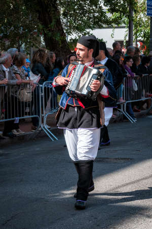 Nuoro, Sardinia, Italy - August 26 2018: Musician with the accordion in the parade of traditional costumes of Sardinia on the occasion of the Feast of the Redeemer of the August 26, 2018 in Nuoro, Sardinia. Editorial
