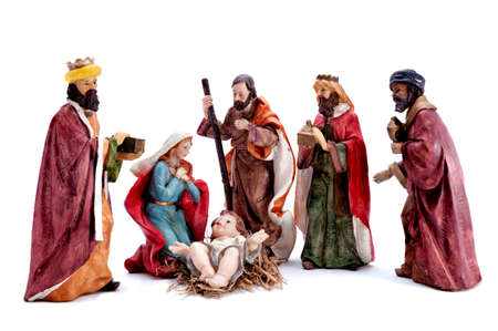 Christmas nativity scene. Baby Jesus in the manger with Mary, Joseph and the three wise men isolated on white background. Archivio Fotografico