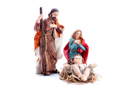 Christmas nativity scene. Baby Jesus in the manger with Mary and Joseph isolated on white background. Stock Photo