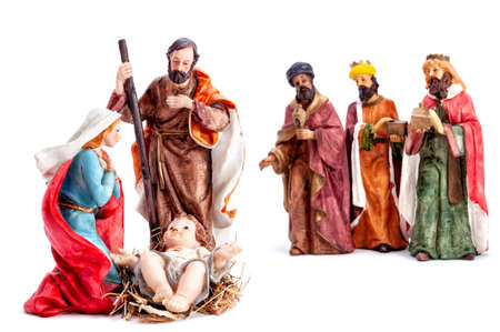 Christmas nativity scene. Baby Jesus in the manger with Mary, Joseph and the three wise men isolated on white background. Stock Photo