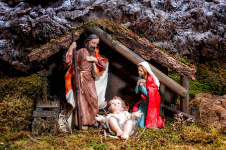 Close-up of the Christmas Nativity scene. Hut with baby Jesus in the manger, with Mary and Joseph