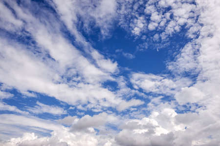 Landscape of a beautiful blue sky covered with cumulonimbus clouds on a warm summer afternoon Stock Photo