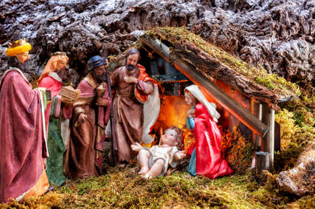 Close-up of the Christmas Nativity scene. Hut with baby Jesus in the manger, with Mary, Joseph and the three wise men.