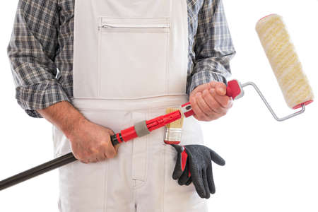 House painter worker with white work overalls, insert the roller to paint in the extension stick. Equipped with protective gloves. Isolated on white background.