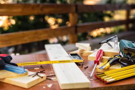 Carpenters square, carpentry tools on a work table. Housework do it yourself. Stock photography.