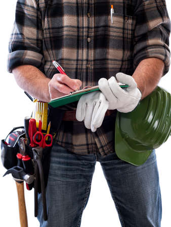 Carpenter isolated on white background writes work notes on a notebook. Work tools industry construction and do it yourself housework. Stock photography.