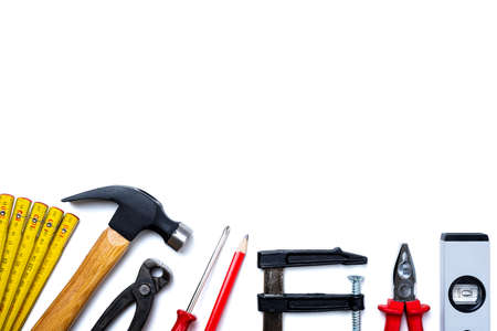 Top view of carpenter's tools on white background. Construction industry, do it yourself. Text space. Archivio Fotografico