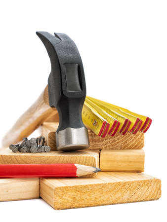Close-up of hammer and carpenter's tools on a white background. Construction industry, do it yourself.