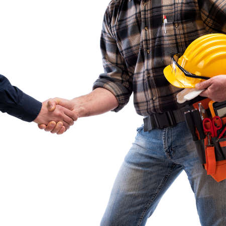 Close-up of a handshake of the electrician carpenter holding helmet and protective goggles in hand. Construction industry, electrical system. Isolated on a white background.