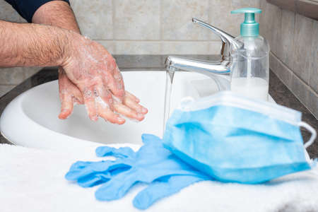 Hand washing with hot soapy water, the use of the mask and gloves stops the infection from Covid-19