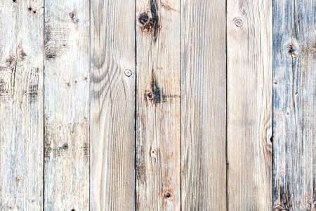 Texture of the planks of an old wooden table in antiqued light pastel colors. Vintage rustic wooden background. Carpentry. Standard-Bild